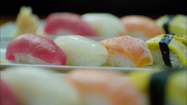 neatly decorated sushi - sushi stock videos and b-roll footage
