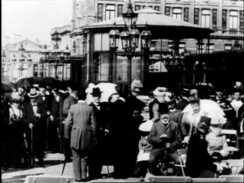 neatly dressed people walking on streets / netherlands - 1910 stock-videos und b-roll-filmmaterial