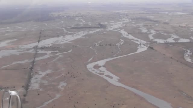 nebraska army national guard soldiers conduct an aerial survey of land affected by severe flooding from fremont to columbus nebraska and use a ch47... - nebraska stock-videos und b-roll-filmmaterial