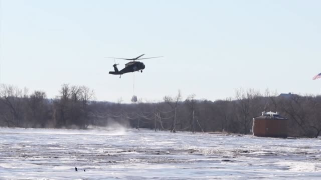 nebraska national guard fill and rig up sandbags with slings and conduct vertical lift hook-up operations with uh-60 black hawk helicopters at the... - embankment stock videos & royalty-free footage