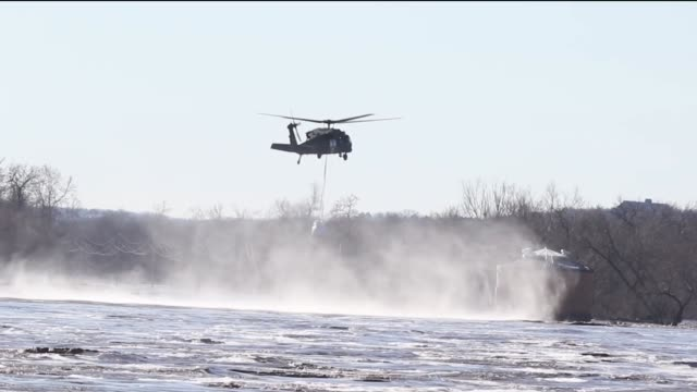 nebraska national guard fill and rig up sandbags with slings and conduct vertical lift hookup operations with uh60 black hawk helicopters at the... - levee stock videos & royalty-free footage
