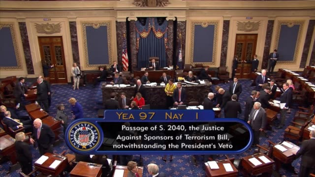 Nebraska Senator Ben Sasse reads out the question before the Senate in passing the Justice Against Sponsors of Terrorism Act over the objections of...