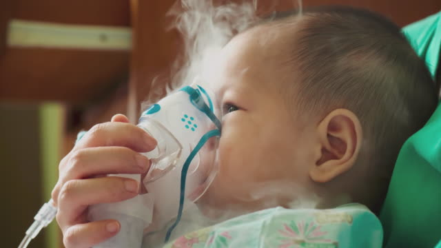 nebulizer treatment for sick infant baby. - aerosol can stock videos & royalty-free footage