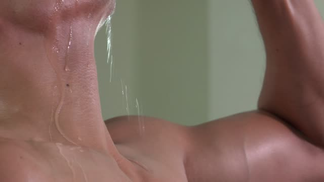 neck of muscular man drinking water close up - chin stock videos and b-roll footage