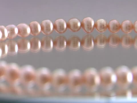 necklace of pink pearls - pearl stock videos and b-roll footage