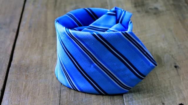 Necktie on wooden floor