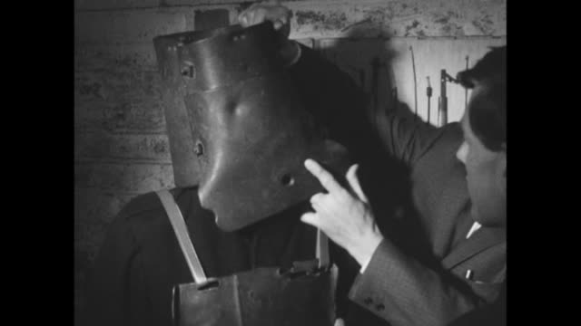 ned kelly's armour has been taken off display at the melbourne musuem so as not to revere a murderer and horse thief men walk through basement of the... - suit of armour stock videos and b-roll footage