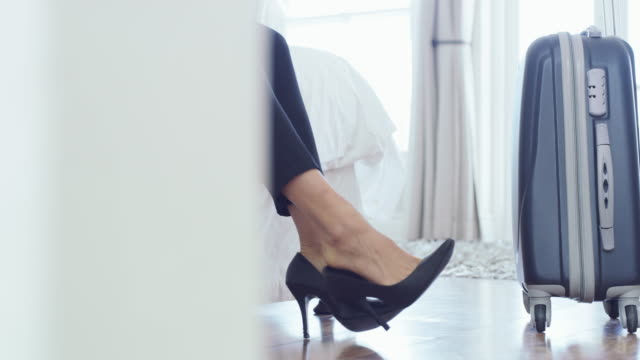 i need some rest after this long trip - high heels stock videos & royalty-free footage