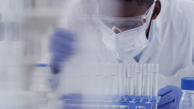 i need this in all the test tubes - biochemist stock videos & royalty-free footage