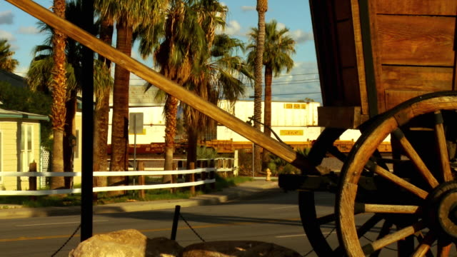 CU, ZO, MS, Needles California sign on side of western pioneer wagon at entrance to city of Needles, California, USA