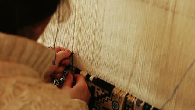 Needlework. Carpet-makers work close-up video.