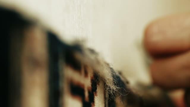 needlework. carpet-makers work close-up video. - webstuhl stock-videos und b-roll-filmmaterial