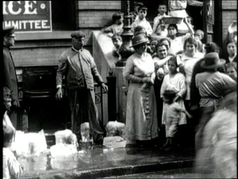 needy women and children receive blocks of ice in a new york city ghetto - 1900 stock videos & royalty-free footage