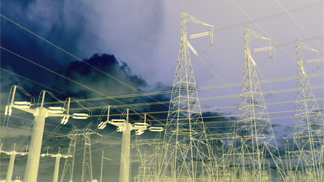 T/L MS Negative image of clouds moving above electric towers and high-voltage high-tension interstate transmission lines, San Joaquin Valley, California, USA