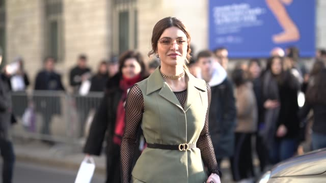 Negin Mirsalehi wears a green sleeveless jacket a green pants a pink Dior Saddle bag sunglasses outside Dior during Paris Fashion Week Haute Couture...