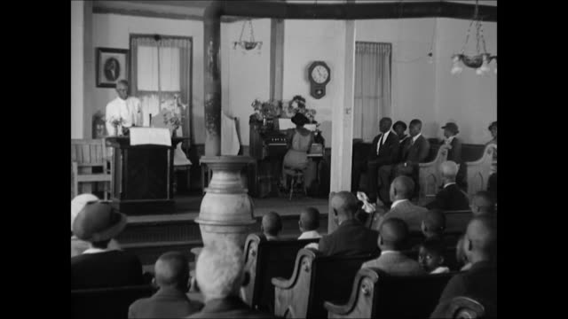 negro-americans going to sunday church. children entering church. int church goers seated minister at podium congregation. minister. black-american... - congregation stock videos & royalty-free footage