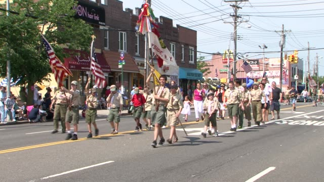 neighborhood boy scouts march in memorial day parade annual little neck-douglaston memorial day parade on may 28, 2012 in little neck , new york - boy scout stock videos & royalty-free footage