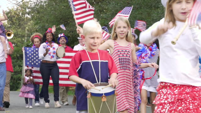 neighborhood july fourth parade - parade stock videos and b-roll footage