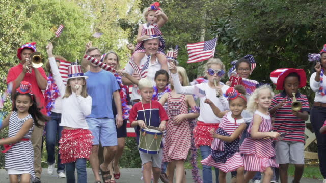neighborhood july fourth parade - participant stock videos & royalty-free footage