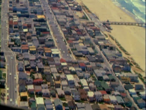 stockvideo's en b-roll-footage met aerial neighborhood of houses crowded near beach front / san pedro, california, united states - 1963