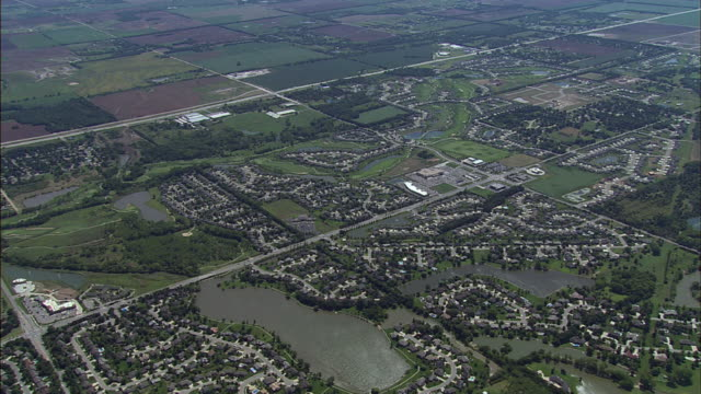 a neighborhood rests between farmlands and lakes in wichita, kansas. - wichita stock videos & royalty-free footage