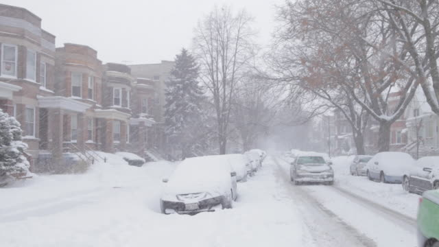 ws neighborhood street covered in snow - snow storm stock videos and b-roll footage