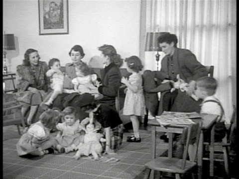 neighborhood street through slanted garage dramatization mother's w/ children in pediatrician's office nurse talking mother out of room w/ her 'dr... - levittown pennsylvania stock videos and b-roll footage