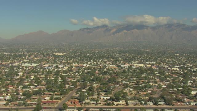 WS AERIAL Neighborhood streets with mountains / Tucson, Arizona, United States