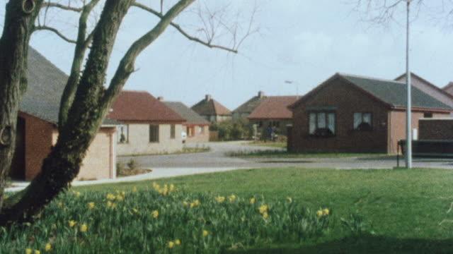 1983 montage neighborhood with small detached houses / lowestoft, england, united kingdom - ローストフト点の映像素材/bロール