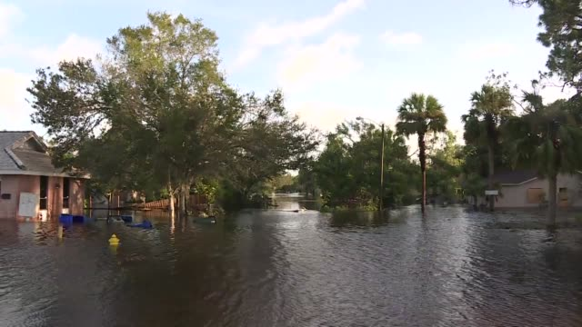 vídeos de stock, filmes e b-roll de neighborhoods in the southwest florida city of bonita springs remain flooded after monster storm irma hit the us state and left 62 million without... - florida us state