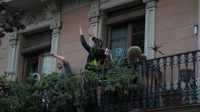 neighbors are seen dancing on their balconies during sant jordi, saint george's day at gracia neighborhood on april 23, 2020 in barcelona, spain.... - balcony stock videos & royalty-free footage