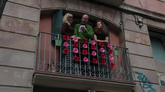 neighbors are seen reading verses and celebrating on their balconies during sant jordi, saint george's day at gracia neighborhood on april 23, 2020... - singing stock videos & royalty-free footage
