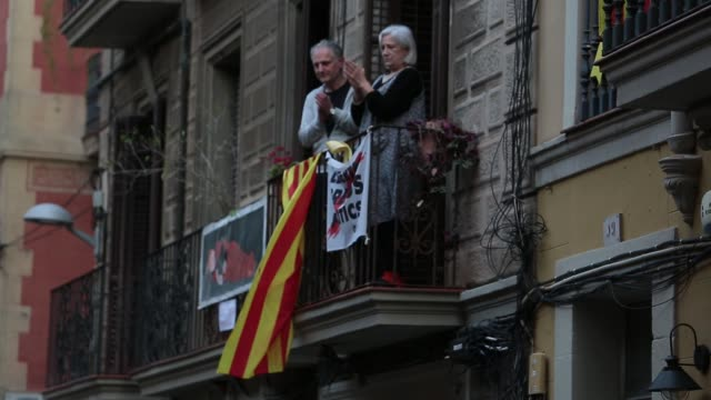 neighbors are seen reading verses and celebrating on their balconies during sant jordi, saint george's day at gracia neighborhood on april 23, 2020... - balcony stock videos & royalty-free footage