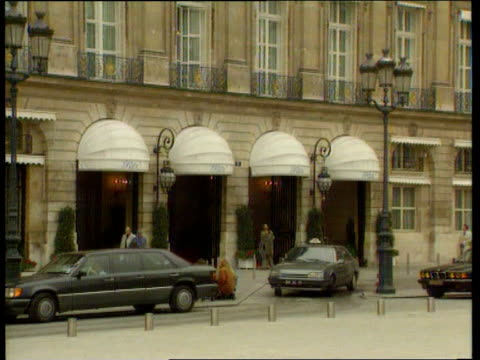 vídeos de stock, filmes e b-roll de libel action against mohammed al fayed itn lib france paris ritz hotel owned by al fayed tilt hotel canopy over entrance to hotel doormen outside... - ritz carlton hotel