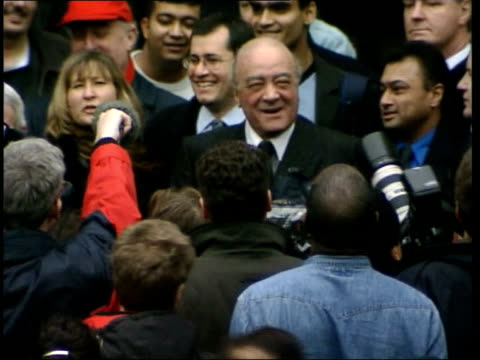 Neil Hamilton loses ITN ENGLAND London Royal Courts of Justice EXT Mohammed Al Fayed standing on court steps waving as surrounded by crowd Laurie...