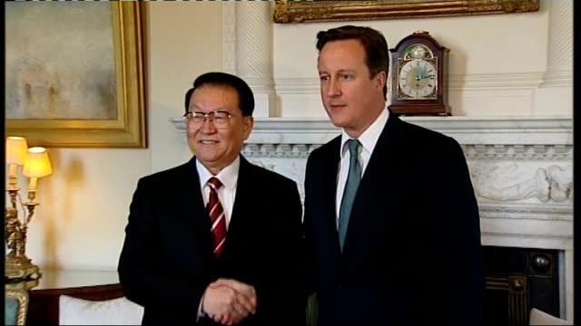 british call for investigation by chinese authorities england london downing street number 10 photography** david cameron mp shaking hands with li... - chinese communist party stock videos and b-roll footage
