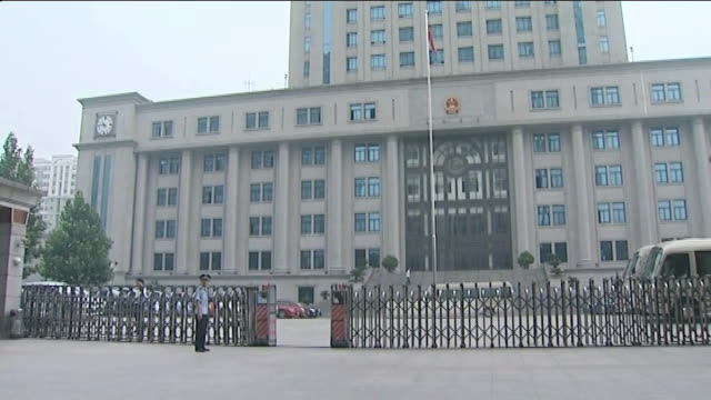 bo xilai trial preview china jinan ext courthouse tilt crest outside court gvs chinese police on guard outside gates to courthouse - courthouse stock videos & royalty-free footage