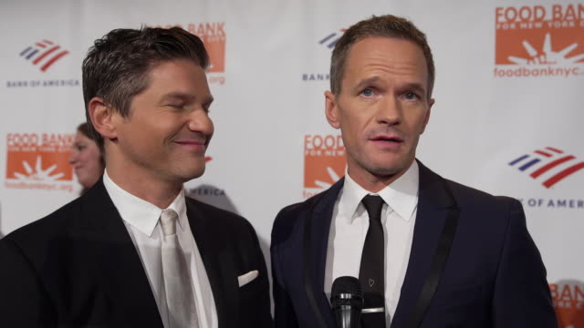 neil patrick harris and david burtka talk about what it means to be honored and the importance of giving back at the food bank for new york city... - ニール・パトリック・ハリス点の映像素材/bロール