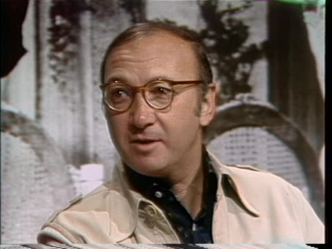 neil simon comments on getting over his fear of flying and the types of planes he likes to travel in during an interview on june 10, 1976. - ニール サイモン点の映像素材/bロール
