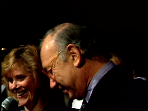 neil simon talks to reporters on the red carpet. - ニール サイモン点の映像素材/bロール