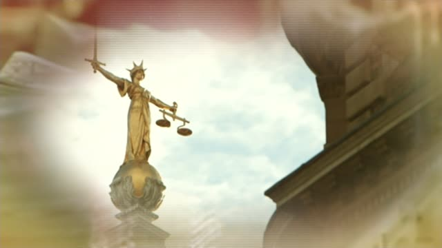 neil wallis former deputy editor of the news of the world found not guilty of conspiring to hack phones t30061415 / tx statue of lady justice on top... - lady justice stock videos and b-roll footage
