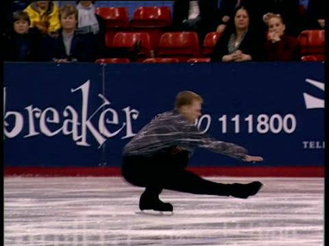 neil wilson performs sit spin during short programme, british figure skating championships, belfast; nov 99 - spinning stock videos & royalty-free footage