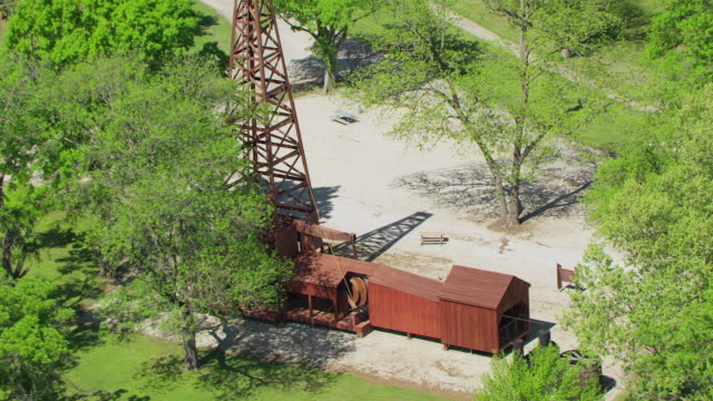 WS AERIAL ZO Nellie Johnstone one Replica at original site of first commercial oil well drilled / Bartlesvile, Oklahoma, United States