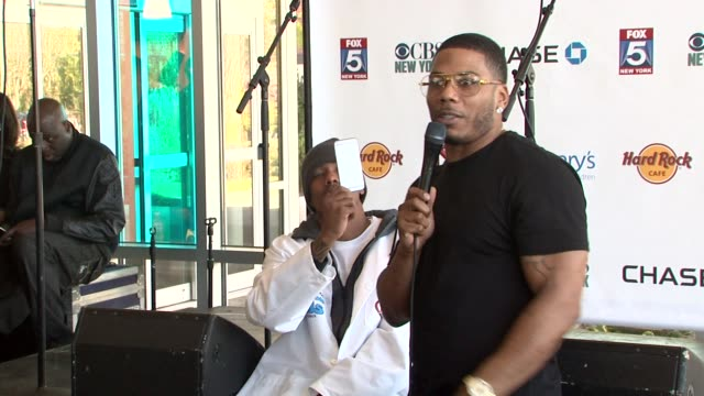 speech nelly discusses visiting st mary's at nick cannon rocks lights empire state building for st mary's kids at the empire state building on... - moderne rockmusik stock-videos und b-roll-filmmaterial