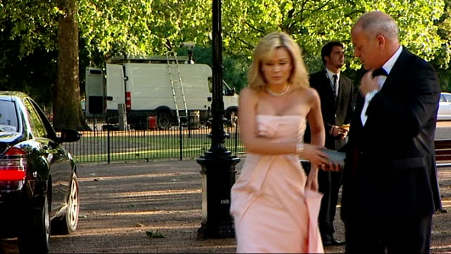 Nelson Mandela 90th birthday dinner in Hyde Park celebrity arrivals Roger Taylor arriving with female guest / Katherine Jenkins arrival / Emma...