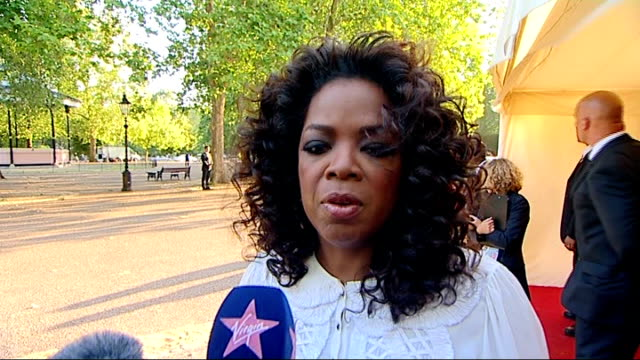 nelson mandela 90th birthday dinner in hyde park celebrity arrivals more of oprah winfrey speaking to press sot good work done through concerts... - oprah winfrey stock videos & royalty-free footage