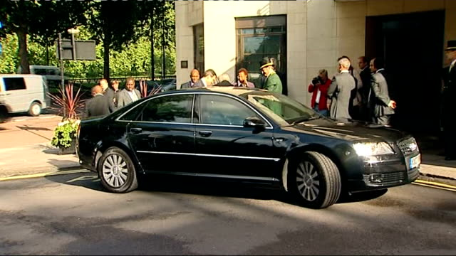 nelson mandela arrives in britain for 90th birthday celebrations; england: london: dorchester hotel: ext car arrives as dame graca machel out of car... - dorchester hotel stock videos & royalty-free footage