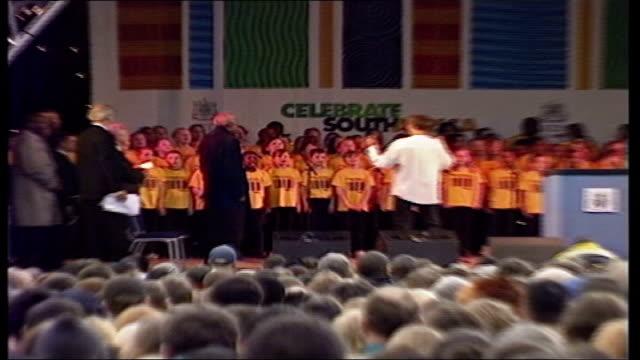 nelson mandela british tour: arrival and speech in leeds; england: leeds: ext bv nelson mandela on stage. as children singing / mandela presented... - leeds stock videos & royalty-free footage