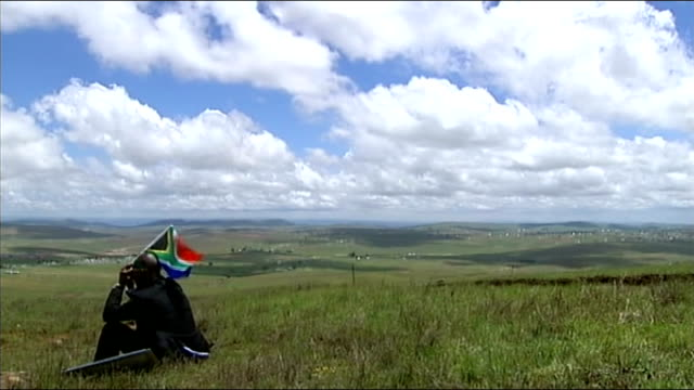 nelson mandela buried at state funeral service; *uk rights only, no international use* fly past watched by people on hillside, some holding staffs... - leopard stock videos & royalty-free footage