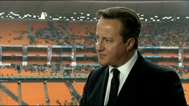 nelson mandela death memorial service held david cameron interview south africa johannesburg ext david cameron mp interview sot very important to... - memorial event stock videos and b-roll footage